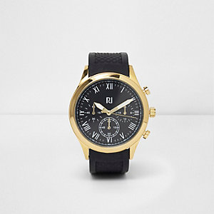 Black and gold tone round face watch