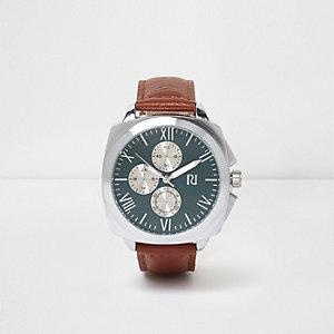 Hellbraune, runde Armbanduhr mit türkisem Zifferblatt