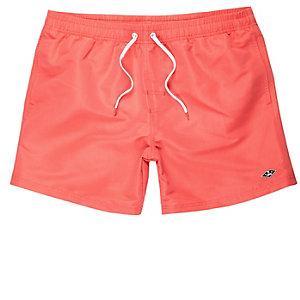 Coral orange swim shorts