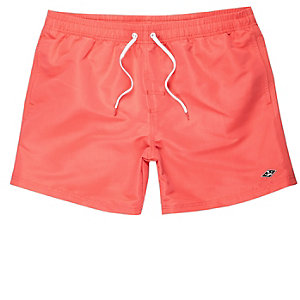 Coral orange swim trunks