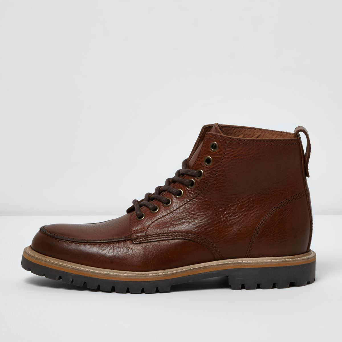 Tan brown lace-up leather boots