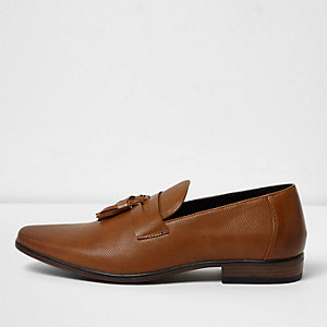 Tan perforated tassel loafers