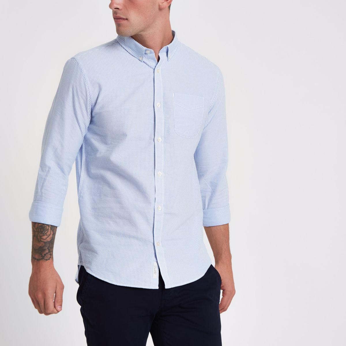 Chemise slim rayée bleue à manches retroussées