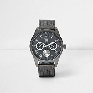 Graue, runde Armbanduhr mit Mesh-Armband