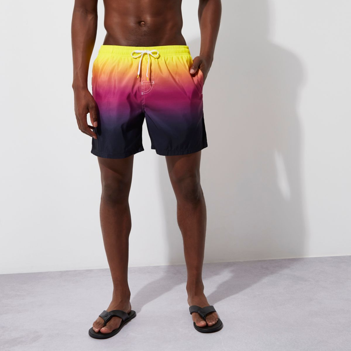Yellow tie dye swim trunks