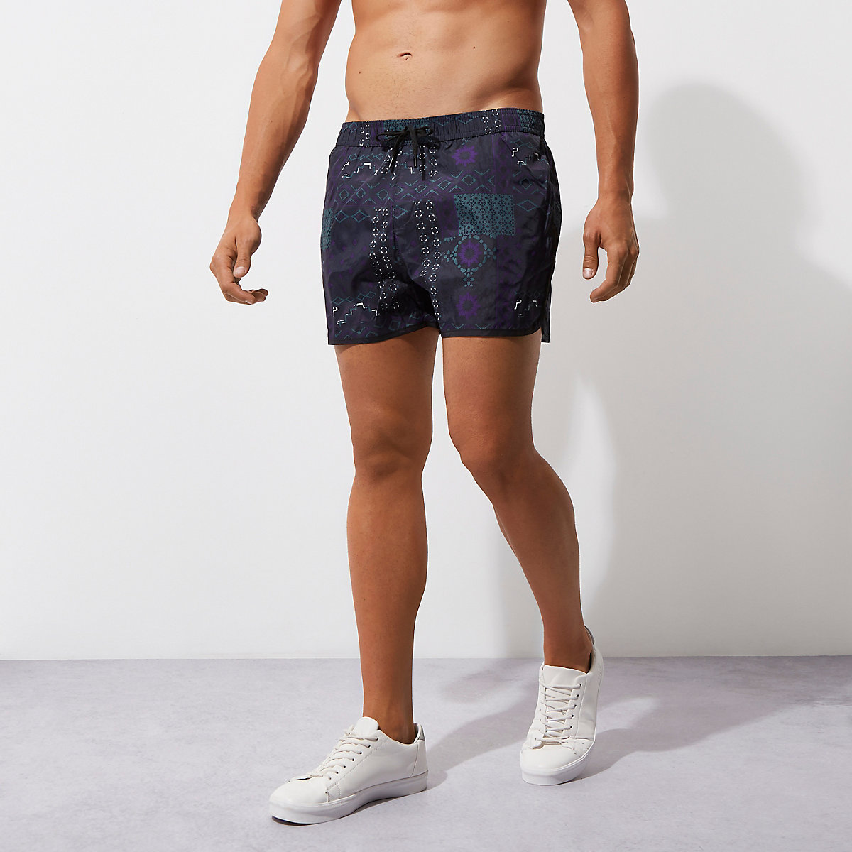 Dark blue tile print runner swim trunks