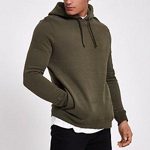 Donkerkakigroene hoodie met rits op de mouw