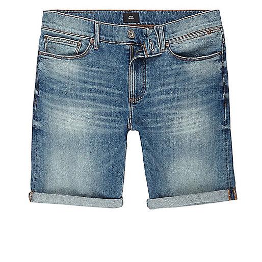 Blue skinny green cast denim shorts