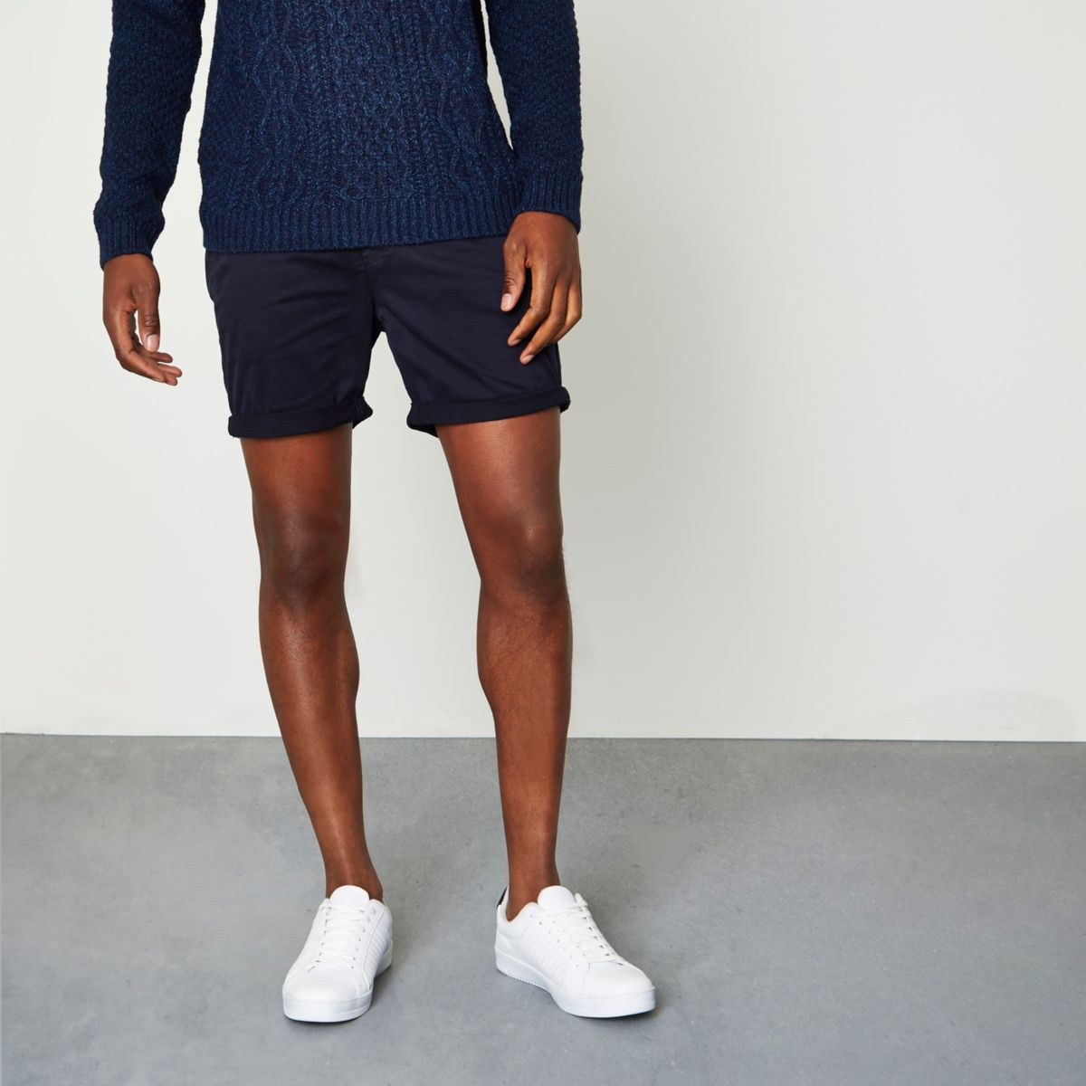 Navy rolled hem chino shorts