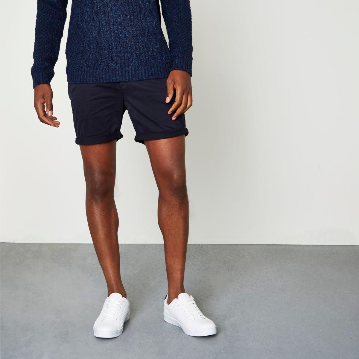 Navy rolled hem chino shorts