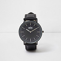 Black strap round face watch