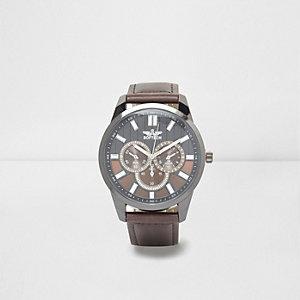 Brown split dial round face watch
