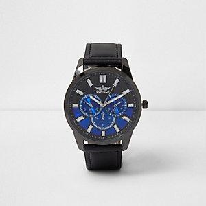 Schwarze und blaue, runde Armbanduhr