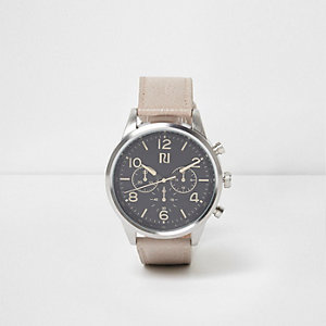 Cream strap round black face watch