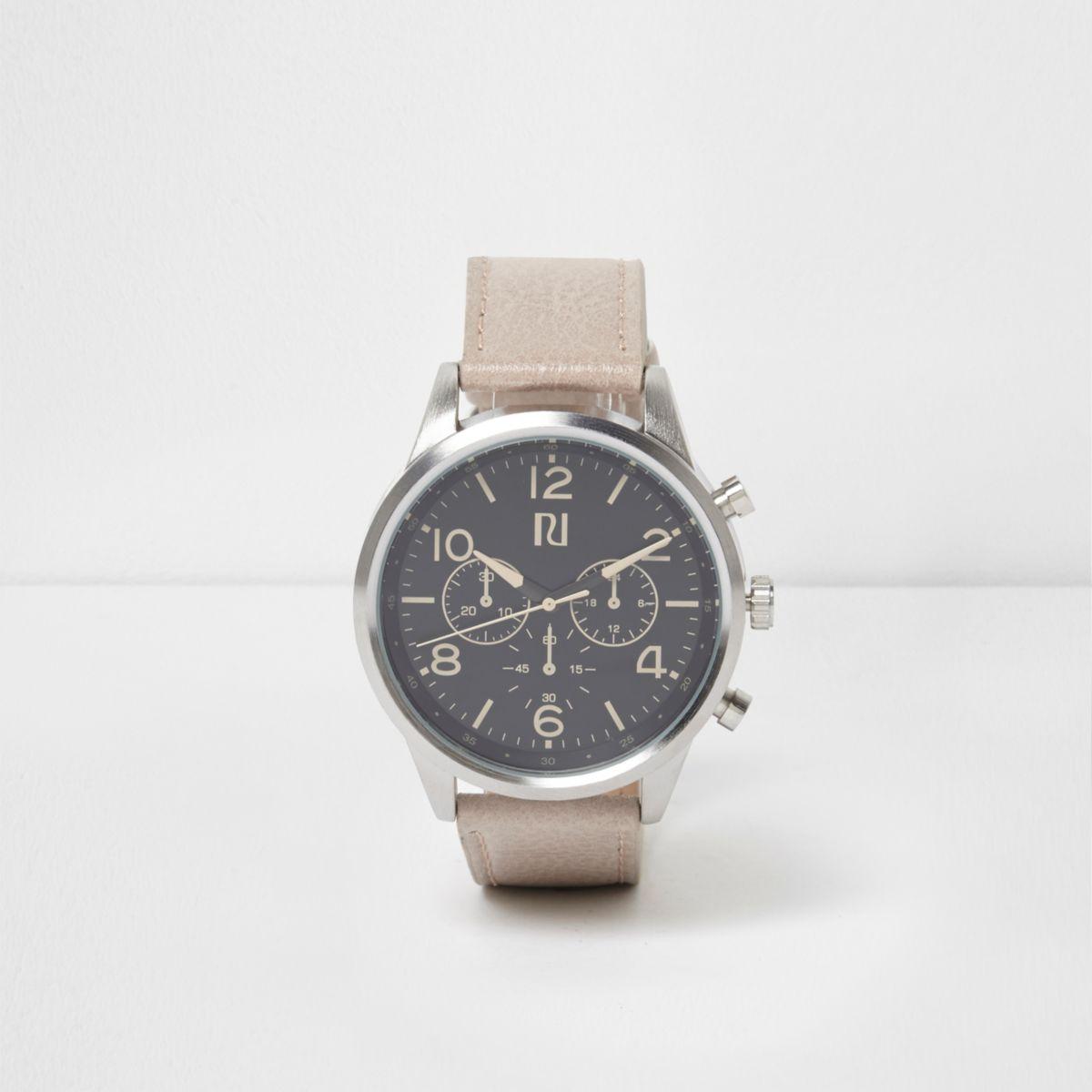 Cream strap round black face watch