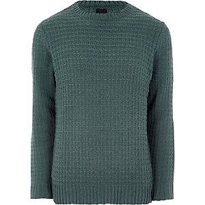 Dunkelgrüner, strukturierter Pullover