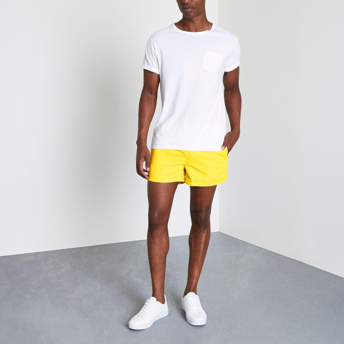 Neon yellow swim shorts