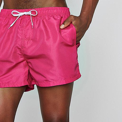 Bright pink swim shorts