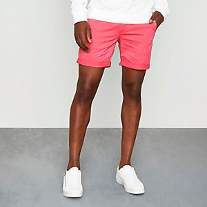 Bright red rolled hem chino shorts