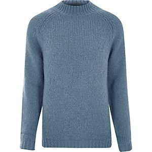 Lichtblauwe pullover met hoge boord