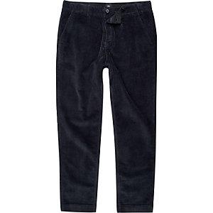 Marineblauwe corduroy smaltoelopende broek