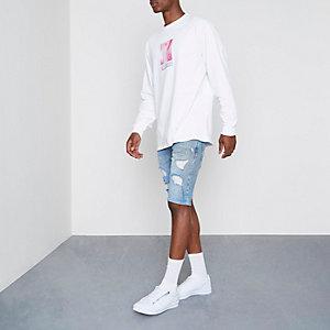 Short en jean skinny délavage bleu clair déchiré
