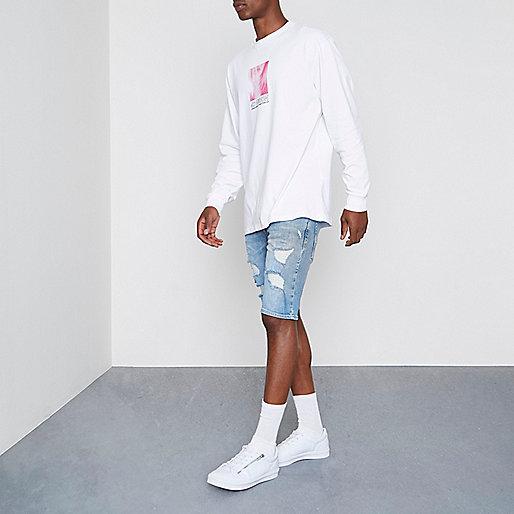 Light blue wash ripped skinny denim shorts