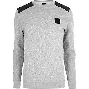 Grau melierter Pullover mit Aufnähern