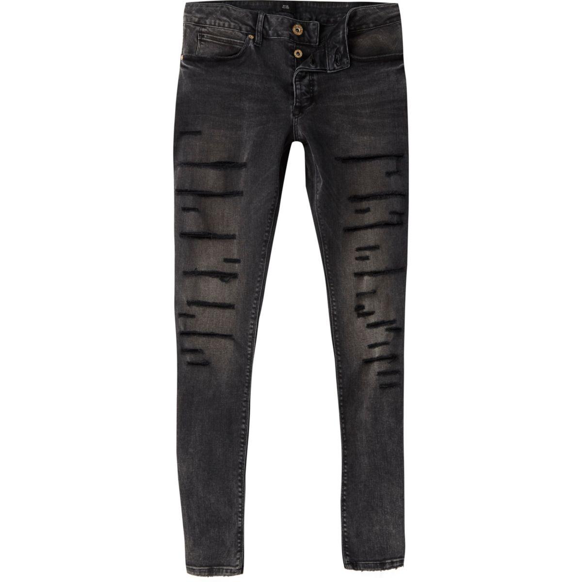 Black Ollie super skinny spray on rip jeans