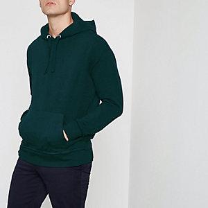 Bosgroene ruimvallende hoodie met lange mouwen