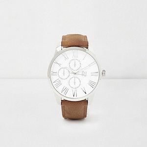 Lichtbruin rond horloge met zilverkleurige wijzerplaat