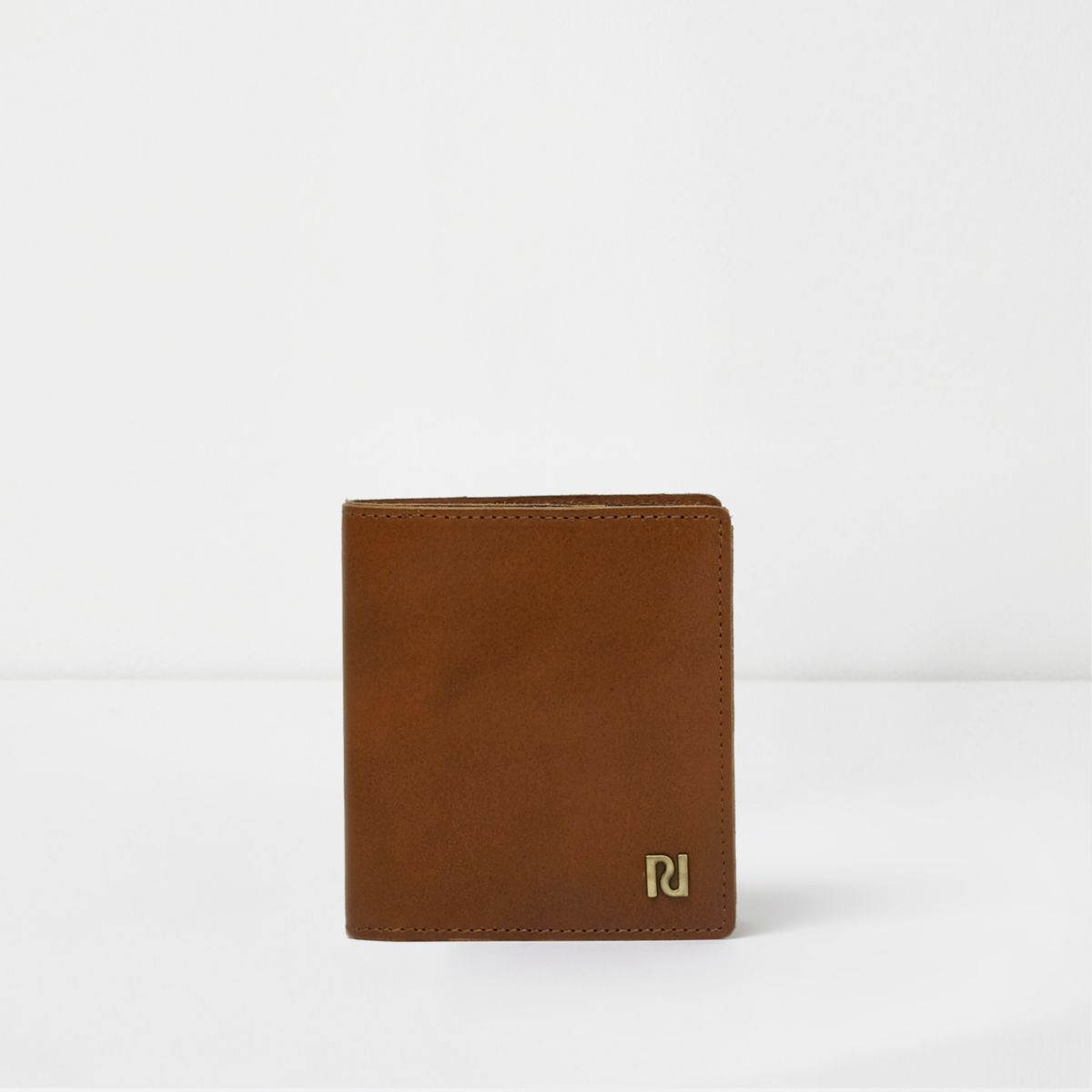 Tan brown trifold leather wallet