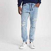 Jean bleu clair déchiré style pantalon de jogging