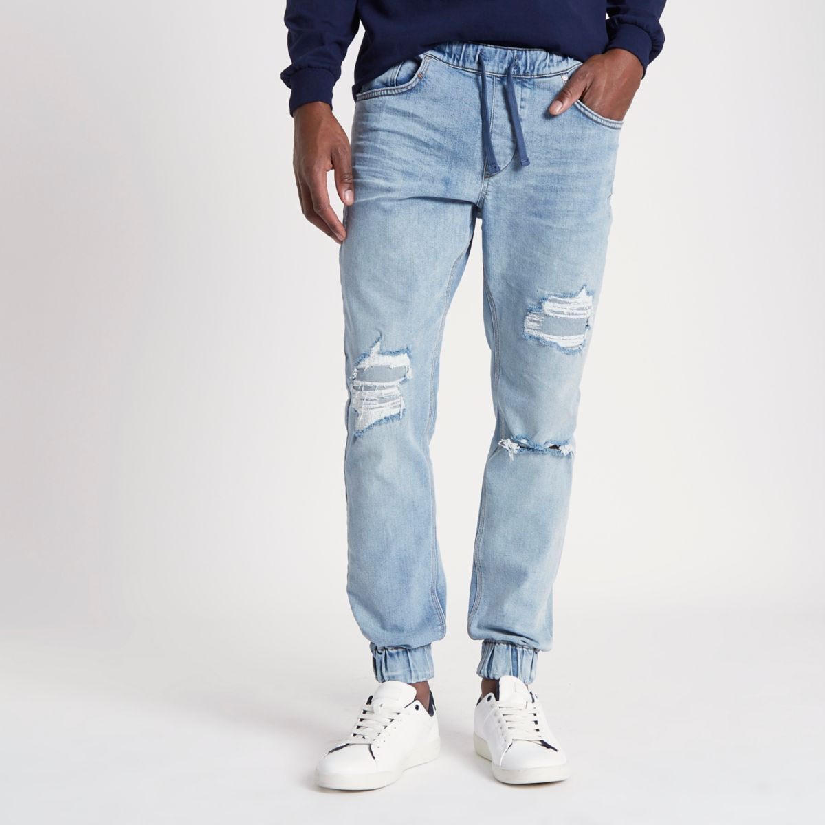 Light blue ripped jogger jeans