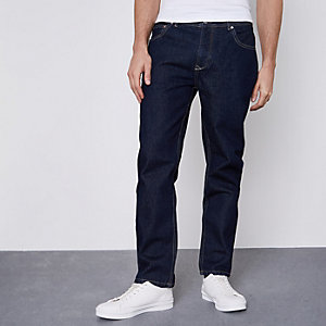 Donkerblauwe smaltoelopende jeans