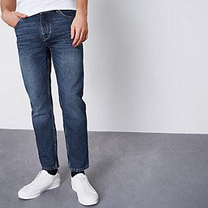 Jimmy - Middenblauwe washed smaltoelopende jeans