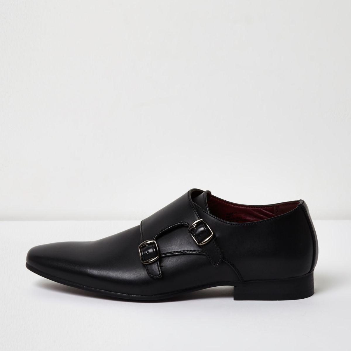 Chaussures noires avec bride et boucle
