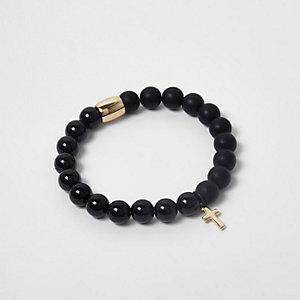 Bracelet noir à perles et croix