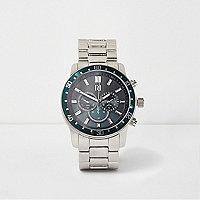 Silberne Armbanduhr mit grünem Ziffernblatt