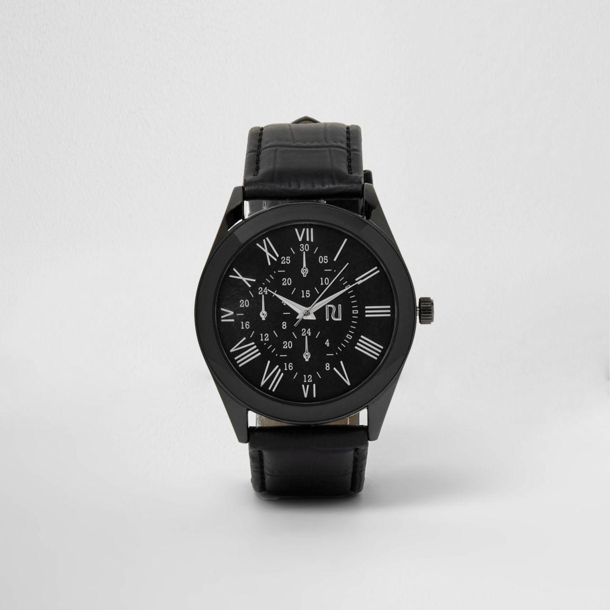 Zwart horloge met ronde wijzerplaat en bandje met krokodillenprint in reliëf