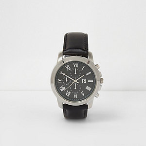 Black and green round watch