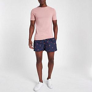 Short de bain bleu marine à imprimé rose
