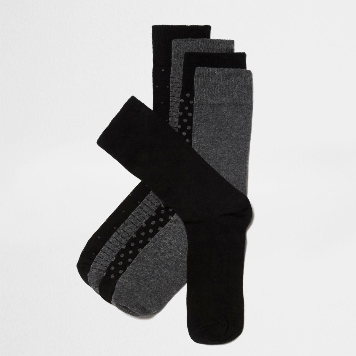Schwarze, gepunktete Socken im Set