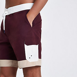 Burgundy color block board swim trunks