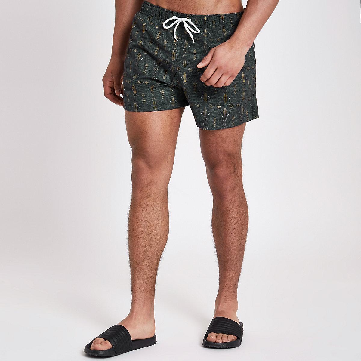 Green aztec print short swim trunks
