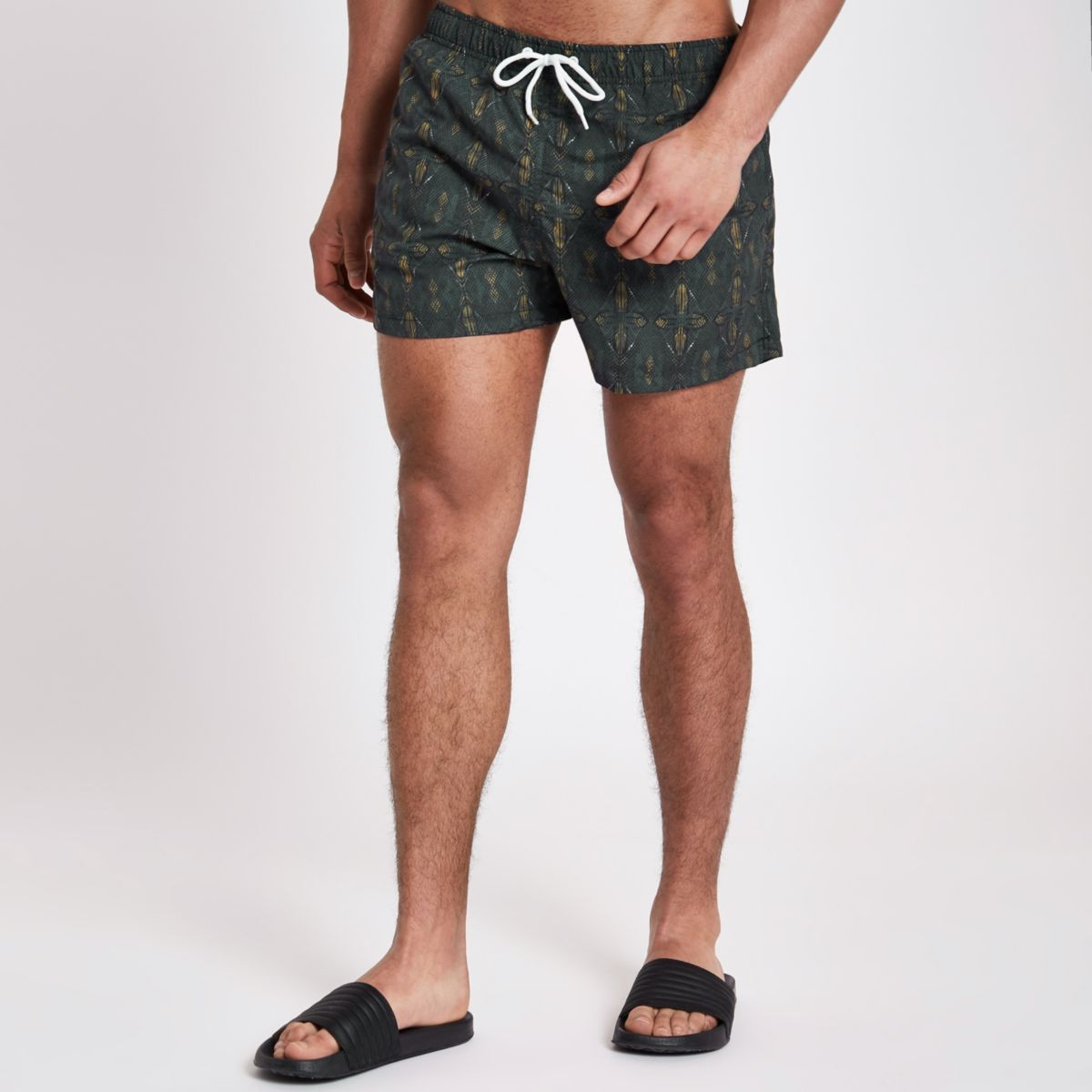 Brown aztec print short swim trunks