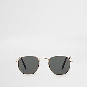 Goudkleurige zonnebril met rokerige zeshoekige glazen