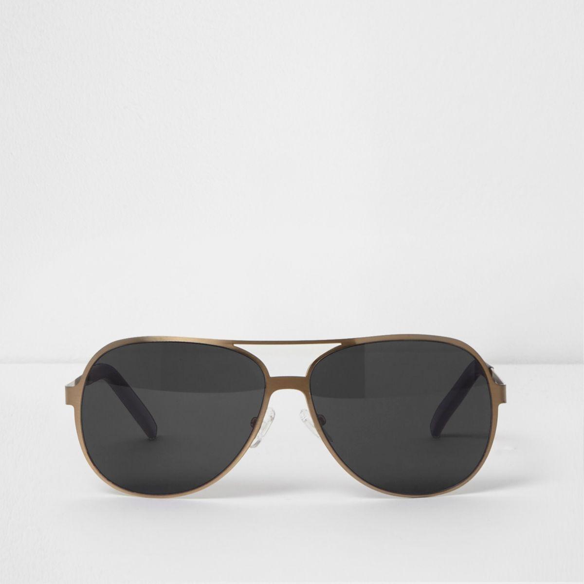 Gold tone smoke lens aviator sunglasses