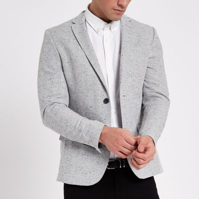 Men's Grey Blazer Light Grey Blazer. While many blazers can appear heavy when worn in warm weather, soft grey styles look bright and breezy. As such, a light grey blazer is a perfect option for functions throughout summer and spring.