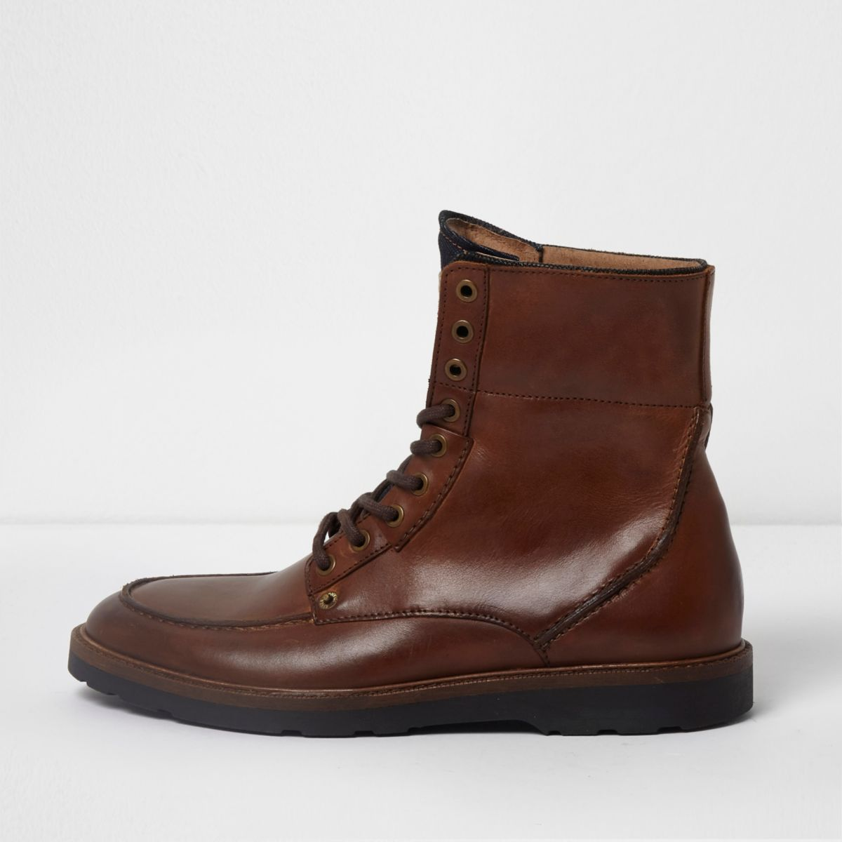 Tan leather apron toe lace-up boots
